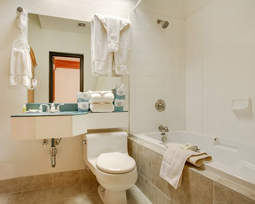 A bathroom with a bathtub and shower stall.