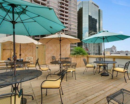 An outdoor fine dining restaurant alongside multi story units.