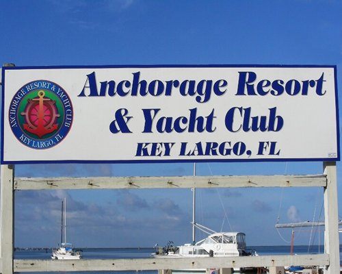 Signboard of the Anchorage Resort and Yacht Club alongside a marina.
