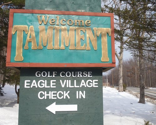 Signboard of the Eagle Village Resort.