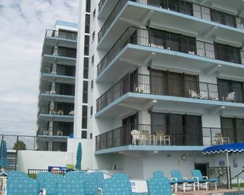 View of chaise lounge chairs alongside the multi story condo.