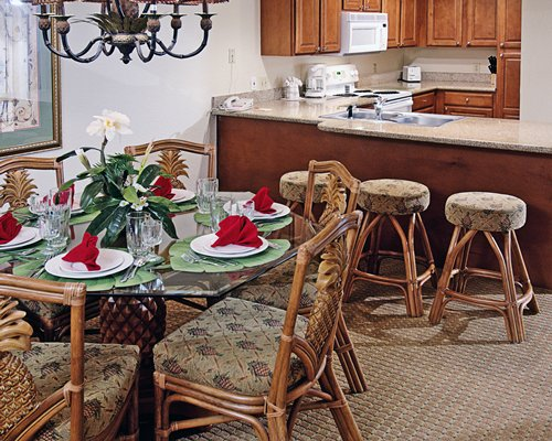 A well equipped kitchen with breakfast bar and dining area.