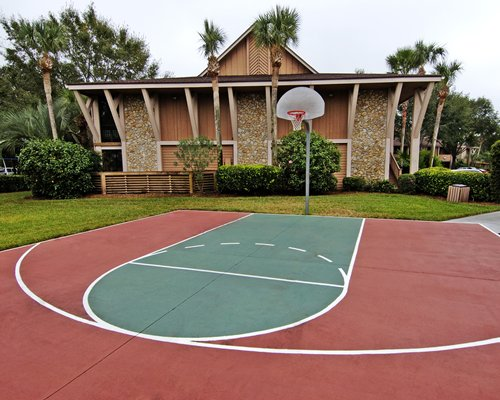 An outdoor basketball court alongside a resort unit.