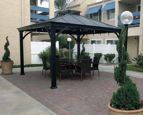 An outdoor patio alongside the resort.