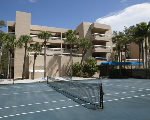 An outdoor tennis court alongside the resort unit.