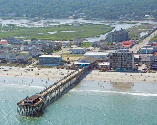 An aerial view of the pier leading to the ocean alongside the resort.