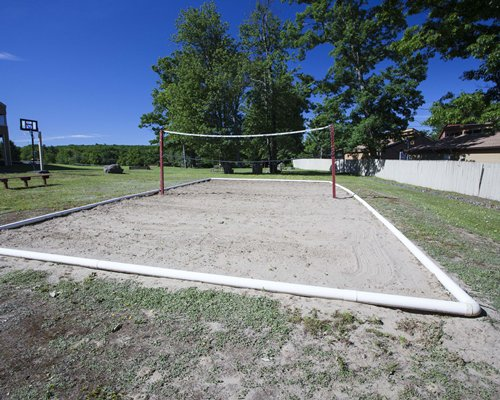 An outdoor recreational area with the volleyball court.