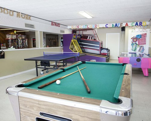 An indoor recreational area with a ping pong and pool table.