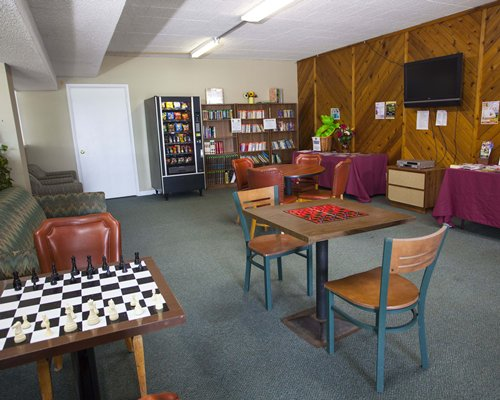 An indoor recreational area with a chessboard and a television.