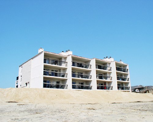 An exterior view of a multi story resort unit with individual balconies.
