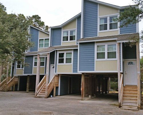 Exterior view of multiple units with stairways at Barrier Island's Ocean Pines Beach.