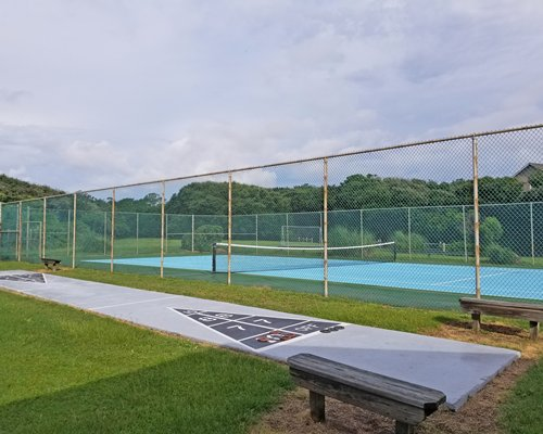 Outdoor shuffle board and tennis court.
