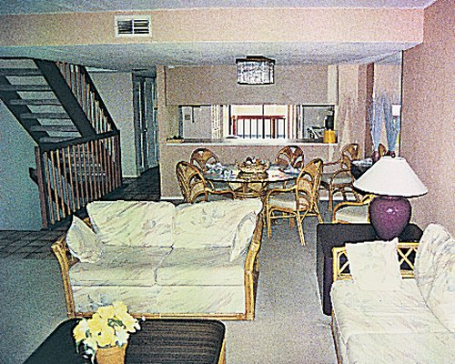 A well furnished living and dining area alongside a kitchen.