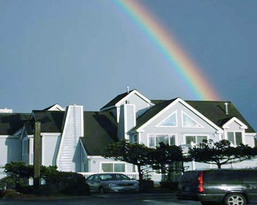 Scenic view of the Schooner Landing resort with parking lot beneath a rainbow.