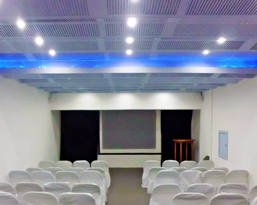 A well furnished theater at Plaza Hotel Club At Acapulco Playa Suites.