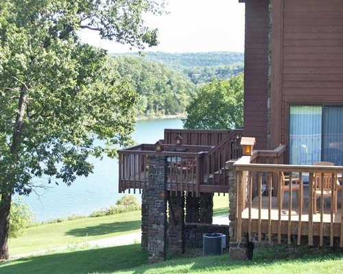 Scenic view of a unit with patio and pathway to Table Rock Landing On Holiday Island alongside the water.