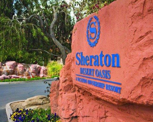 Signboard of Sheraton Desert Oasis resort.