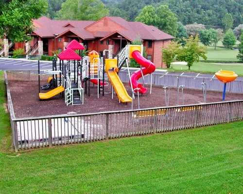 Playground with kids playscape alongside a pathway to units at Bent Creek Golf Village.