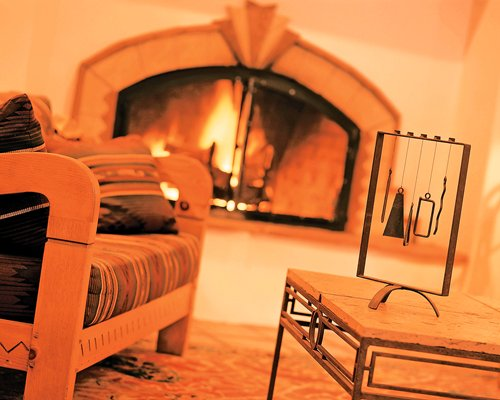 Living room with a fire in the fireplace.