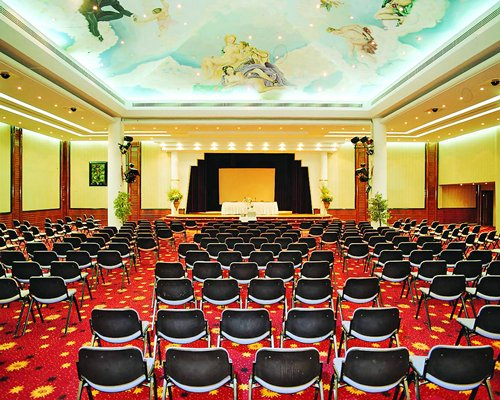 An indoor conference hall with a stage at the resort.
