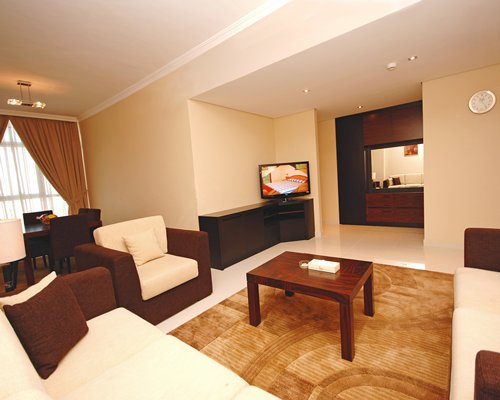 A well furnished living room with a double pull out sofa and television.