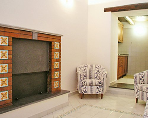 A well furnished indoor room with a fireplace.