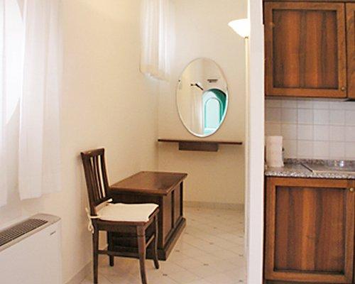 A kitchen alongside a dresser.