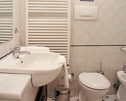 A bathroom with single sink vanity.