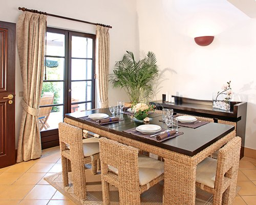 A well furnished dining area with a patio.
