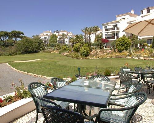 An outdoor restaurant alongside landscaped resort unit.