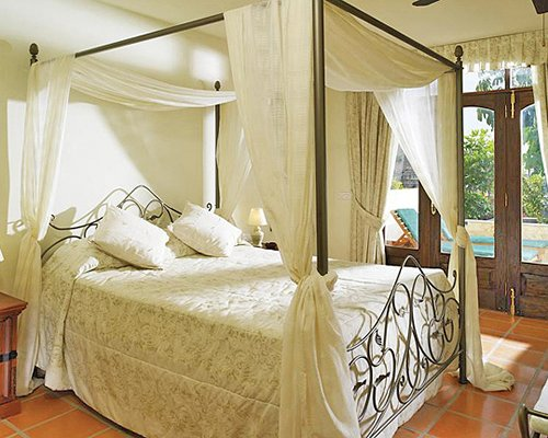 A well furnished bedroom with an outdoor view.