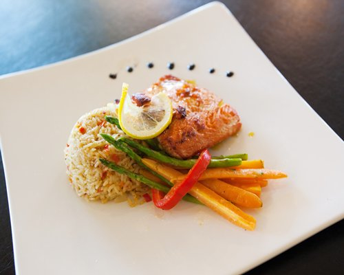 View of garnished food on a plate.