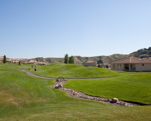 Scenic view of Paradise Canyon Golf Resort with golf course and pathway.