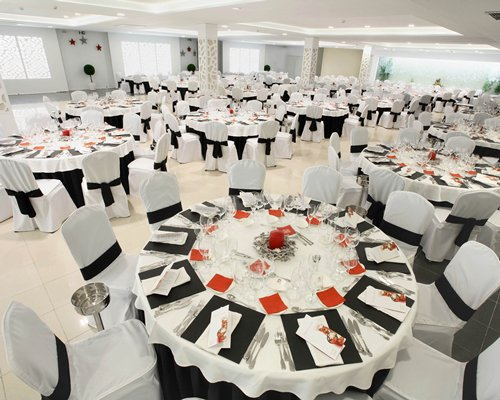 An indoor fine dining restaurant with multiple dining tables.