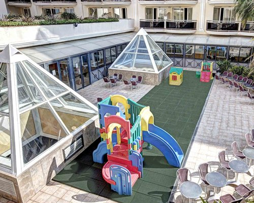An outdoor recreational area with kids playscape alongside the resort unit.