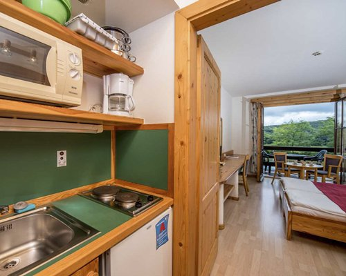 A well equipped kitchen alongside a bedroom.