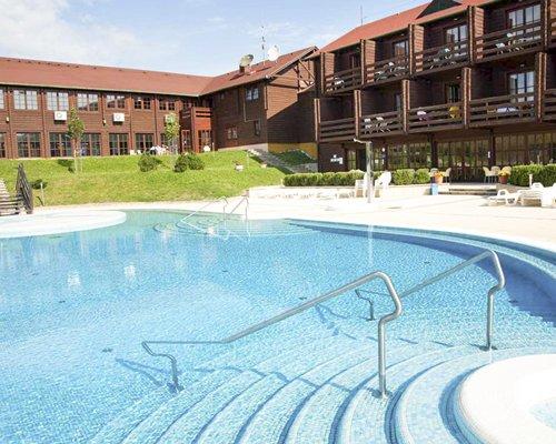 An outdoor swimming pool alongside the Petnehazy Club Hotel.