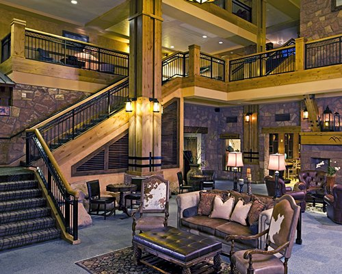Lounge area with stairway and indoor balcony.