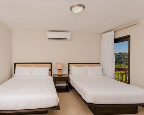 A well equipped kitchen with breakfast bar alongside a stairway.