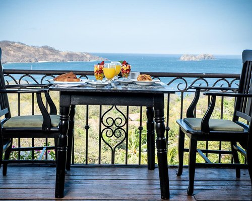 A well equipped bar with a beach view.
