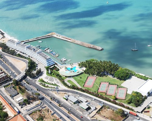 Birds eye view of the Marina Park Hotel resort and resort property alongside the beach.