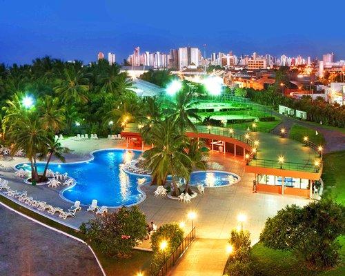 An exterior view of the Marina Park Hotel resort at night.