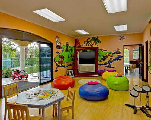 An indoor kid's recreational area with a television.