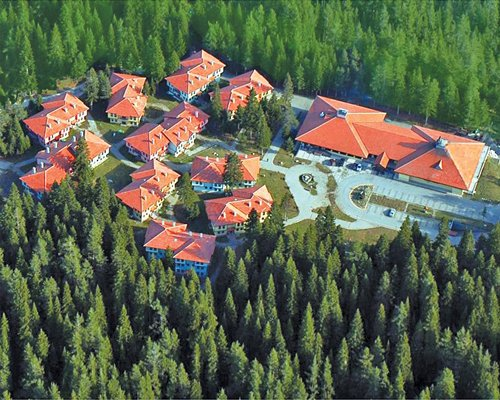 An aerial view of resort property surrounded by wooded area.