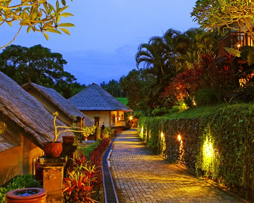 A pathway alongside the resort at night.