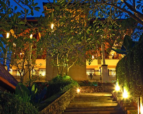 Night view of a stairway leading to the resort.