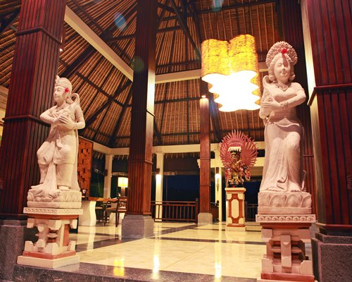 A hallway with statues.