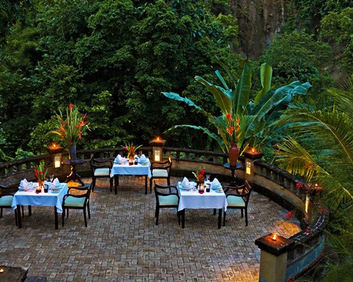 An outdoor dining area surrounded by trees.