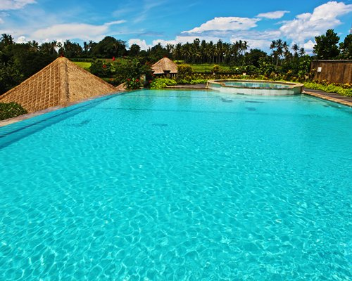 An outdoor large swimming pool at the resort.