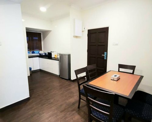 A kitchen with a microwave oven and outside view.